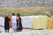 Albanian women living in the old town selling traditional embroidered hand made cloth. Berat upper citadel old walled city. Albania, Balkan, Europe.