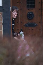 © Licensed to London News Pictures. 25/02/2016. Barnet, UK. Veteran DJ Tony Blackburn's wife Deborah Thomson receives flowers from a neighbour after it was announced that he has been sacked by the BBC. Photo credit: Peter Macdiarmid/LNP