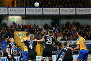 Grimsby Town defender Mattie Pollock (25) heads the ball clear during the EFL Sky Bet League 2 match between Mansfield Town and Grimsby Town FC at the One Call Stadium, Mansfield, England on 4 January 2020.