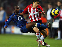 Fotball<br /> Foto: BPI/Digitalsport<br /> NORWAY ONLY<br /> <br /> 24/11/2004 PSV Eindhoven v Arsenal<br /> UEFA Champions League, Philips Stadion, Eindhoven<br /> <br /> Lauren flies in on Lee Young-Pyo and receives a second yellow