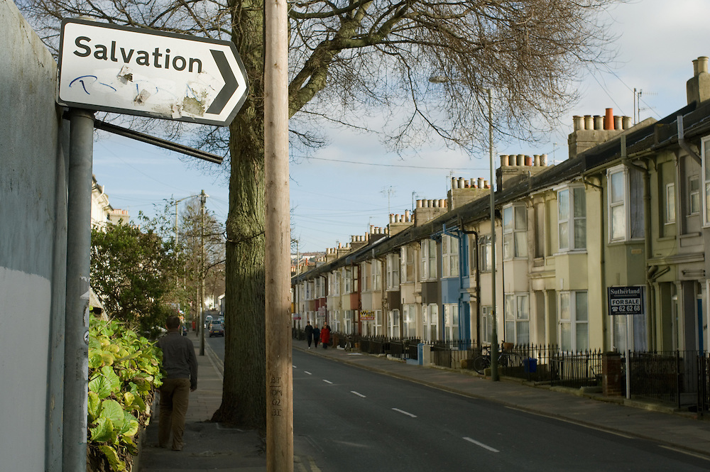 A roadsign points the way to 'Salvation' on a quiet street in Brighton. England 2008.