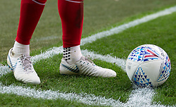 Close up of a players football boots and the match ball