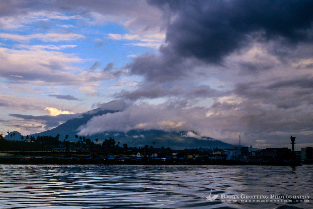 Indonesia, Sulawesi, Manado. Manado harbour with Mount Klabat in the background.