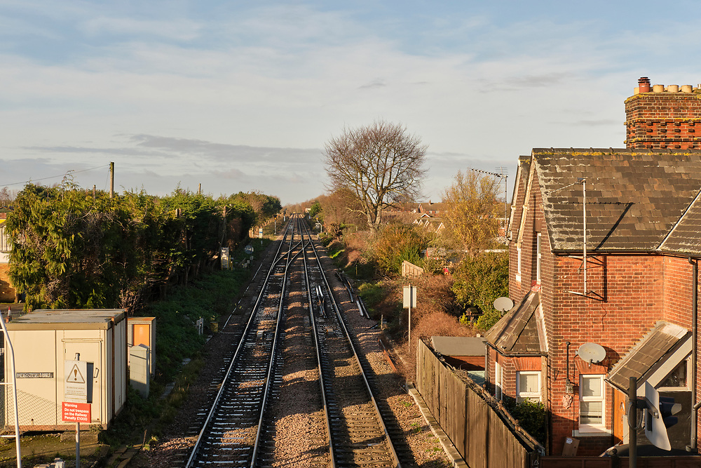 Landscape view down from the footbridge at Trimley Station. Signal switching and relay equipment on the left. The additional track on the left was added only recently to increase the capacity of the line from the Port of Felixstowe.<br /> <br /> Photo by Jonathan J Fussell, COPYRIGHT 2020