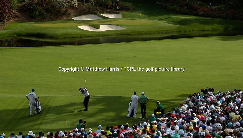Bubba WATSON (USA) tee shot at 12th par 3 during fourth round US Masters 2014,Augusta National,Augusta, Georgia,USA.