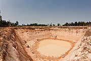 08 APRIL 2010 - NAKHON PHANOM, THAILAND: A nearly dried out fish pond in Nakhon Phanom province, Thailand. The region is in the midst of a record setting drought and the Mekong River is at its lowest point in nearly 50 years, setting up an environmental disaster the region has never seen before. Many of the people who live along the river farm and fish. They claim their crops yields are greatly reduced and that many days they return from fishing with empty nets. The river is so shallow now that fisherman who used to go out in boats now work from the banks and sandbars on foot or wade into the river. In addition to low river levels the Isan region of Thailand is also in the midst of a record drought and heat wave. Farmers have been encouraged to switch from rice to less water intensive crops and to expect lower yields. Farmers here rely more on rain fall than irrigation to water their crops.       PHOTO BY JACK KURTZ