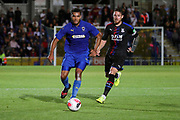 AFC Wimbledon defender Reuben Collins (36) dribbling past Crystal Palace Connor Wickham (21) during the Pre-Season Friendly match between AFC Wimbledon and Crystal Palace at the Cherry Red Records Stadium, Kingston, England on 30 July 2019.