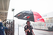 Rain dominated the Friday and in such excess that the second practice session had to be cancelled.  team staff member with umbrella<br /> Regen verursacht Annullierung des zweiten Freitags-trainings -<br /> Formula One, F1 Grand Prix in Austin, TEXAS, USA 2015 - on October 22nd. Formula One, Formel 1, Formule 1  - circuit of the Americas -  fee liable image - Photo Credit: © ATP / Alex WONG