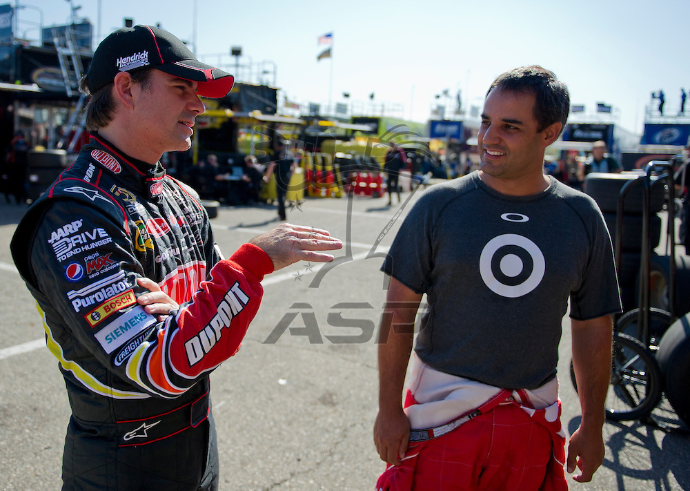Brooklyn, MI - JUN 14, 2012:  Jeff Gordon (24) and Juan Pablo Montoya (42) talk during the first test session for the Quicken Loans 400 race at the Michigan International Speedway in Brooklyn, MI.