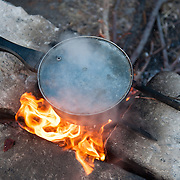 Leila 31yo from Afghanistan boiling water to make tea in Kara Tepe camp.