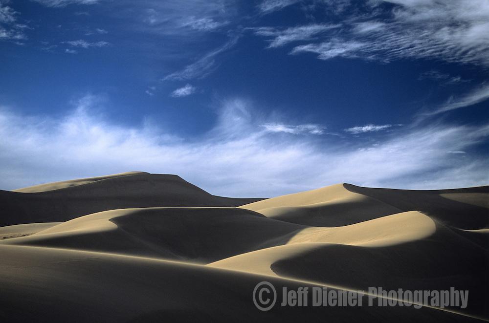 Shadows fall on Great Sand Dunes National Park, Colorado.