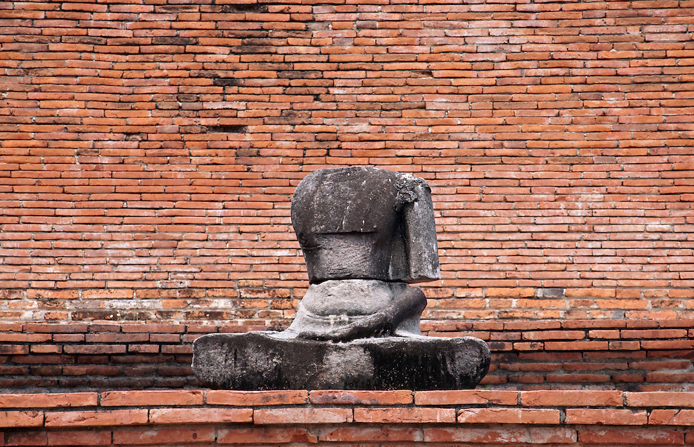 Headless buddha statue found within Ayutthaya city, Thailand.