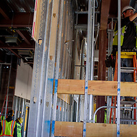 Apprentice electrician Sean Nacki works on the wiring for the new Ramah Elementary School in Ramah Wednesday.