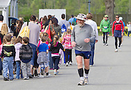 Augusta, New Jersey - Paul Heckert (336) and other runners move past children on a class trip during the 3 Days at the Fair races at Sussex County Fairgrounds on May 11, 2012.
