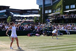 Harriet Dart and Katy Dunne (left) during their doubles match against Heather Watson and Naomi Broady on day four of the Wimbledon Championships at The All England Lawn Tennis and Croquet Club, Wimbledon.
