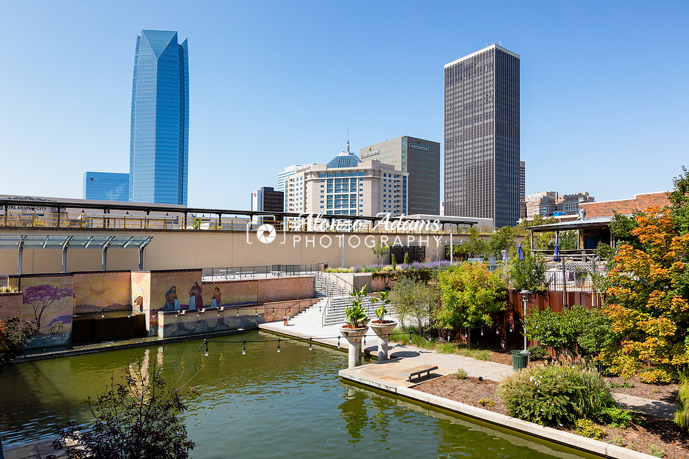 Bricktown canal with the downtown skyline in the background. Photo copyright © 2020 Alonzo J. Adams.