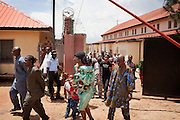 Christian devotees are walking outside a security gate after a Mass Service celebrated by the Archbishop of Jos, Ignatius Kaigama, 54, at the Christian Catholic Cathedral Of Our Lady Fatima in Jos, Plateau State, Nigeria.