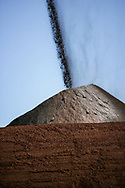 Iron ore is stacked ready for processing at an ore processing plant in the Pilbara region of Western Australia.