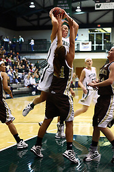 17 December 2011: Olivia Lett  passes off when confronted by Michelle Karrduring an NCAA womens division 3 basketball game between the St. Francis Fighting Saints and the Illinois Wesleyan Titans in Shirk Center, Bloomington IL