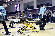 HIGH POINT, NC - JANUARY 06: Charleston Southern's Christian Keeling raises an arm while being wheeled off the court by medical personnel after he collapsed late in the game. The High Point University of Panthers hosted the Charleston Southern University Buccaneers on January 6, 2018 at Millis Athletic Convocation Center in High Point, NC in a Division I men's college basketball game. HPU won the game 80-59.
