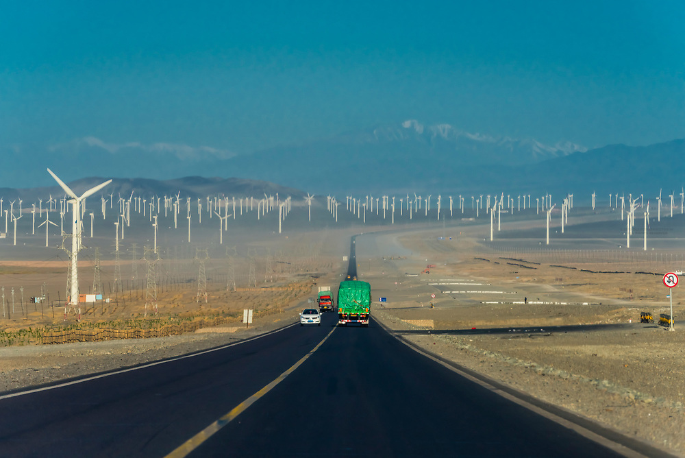 Wind turbines next to the highway between Turpan and Urumqi in Xinjiang Province, China.