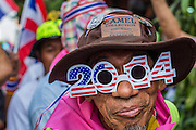 05 JANUARY 2014 - BANGKOK, THAILAND: An anti-government marcher in Bangkok wearing sunglasses from the New Year. Suthep Thaugsuband, leader of the anti-government protests in Bangkok, led the protestors on a march through the Chinatown district of Bangkok. Tens of thousands of people waving Thai flags and blowing whistles gridlocked what was already one of the most congested parts of the city. The march was intended to be a warm up to their plan by protestors to completely shut down Bangkok starting Jan. 13.     PHOTO BY JACK KURTZ