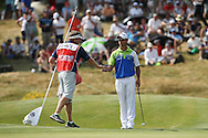 Ball cleaned now make a birdie on the last for -10. Jaco Van Zyl (RSA) did for the lead during Round Three of the 2015 Alstom Open de France, played at Le Golf National, Saint-Quentin-En-Yvelines, Paris, France. /04/07/2015/. Picture: Golffile | David Lloyd<br /> <br /> All photos usage must carry mandatory copyright credit (© Golffile | David Lloyd)