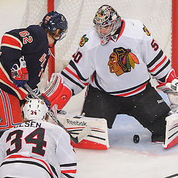 New York Rangers left wing Carl Hagelin (62) scores on Chicago Blackhawks goalie Corey Crawford (50) during third period NHL action between the Chicago Blackhawks and the New York Rangers at Madison Square Garden in New York, N.Y. The Blackhawks defeated the Rangers 4-2.