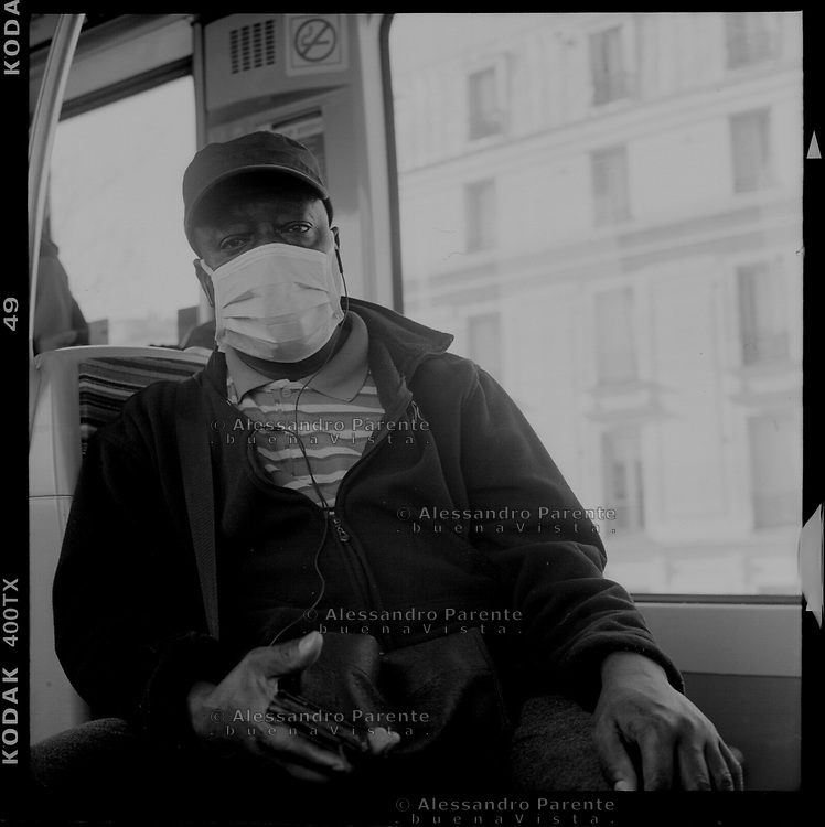 Paris, black man from Seine Saint Denis wearing a mask is going to work by metro.
