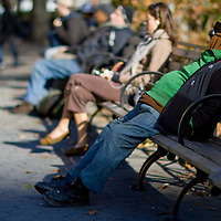 A homeless man with clothing pulled over his head at Union Square Park New York City
