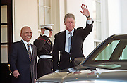 President Bill Clinton and King Hussein of Jordan wave to the media at the White House January 5, 1999 in Washington, DC. The King Hussein is on his way home after six months of cancer treatment in the United States.