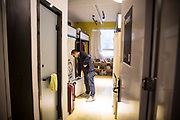 A man walks into his shared room inside a You+ community in Beijing, China, on Monday, Nov. 30, 2015. Nearly 5,000 people across China have moved into co-living spaces called You+, a name meant to inspire young people to infinitely expand their horizons. About 60 startups call the Beijing location home — developing mobile games, services that improve sleep patterns and much more.