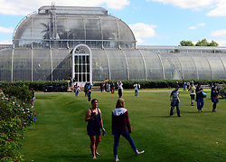 © Licensed to London News Pictures. 02/04/14 About 125 jobs could be cut as the Royal Botanic Gardens in Kew, west London, faces a £5m shortfall in revenue in the coming financial year. FILE PICTURE DATED 31/08/2012. Kew, UK Visitors enjoy the sunshine on the last meteorogical day of summer at Kew Gardens today 31 August 2012. The summer of 2012 has been one of the wettest on record in Britain. Photo credit : Stephen Simpson/LNP