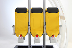 "The latest cost-saving solution to pack passengers into airline's cheap seats has been unveiled. Although the company producing them still call the draconian-looking devices 'seats' the near-standing slope could equally be termed air saddles. Unveiled this month at Hamburg's Airplane Interiors Expo the 'Skyrider 2.0' is designed by Italian aerospace interior design company Aviointeriors Group. And while it might sound like something from Star Wars the Skyrider 2.0 has much simpler appeal to budget operators as according to the company it allows 'an ultra-high density in the aircraft cabin.' An Aviointeriors Group spokesman said: ""Its main feature is the original bottom that ensures an increased upright passenger positon allowing installation of the seat at a reduced pitch, while maintaining an adequate comfort. ""The design of this seat enables to increase the passenger number by 20% allowing increasing profits for airline companies. Furthermore, Skyrider 2.0 weighs 50% less than standard economy class seats and the reduced number of components enable minimum maintenance costs. No company has yet announced plans to adopt the Skyrider 2.0 but there has been an air of resignation around the subject of standing seats since Ryanair first expressed interest in a more punishing version of the Skyrider eight years ago. Ryanair's plans for standing on it's budget flights were thwarted by regulators who scoffed at the idea of standing-room only in 2012 before trials were able to start. 26 Apr 2018 Pictured: Is this the awful future of flying?. Photo credit: EM / MEGA TheMegaAgency.com +1 888 505 6342"
