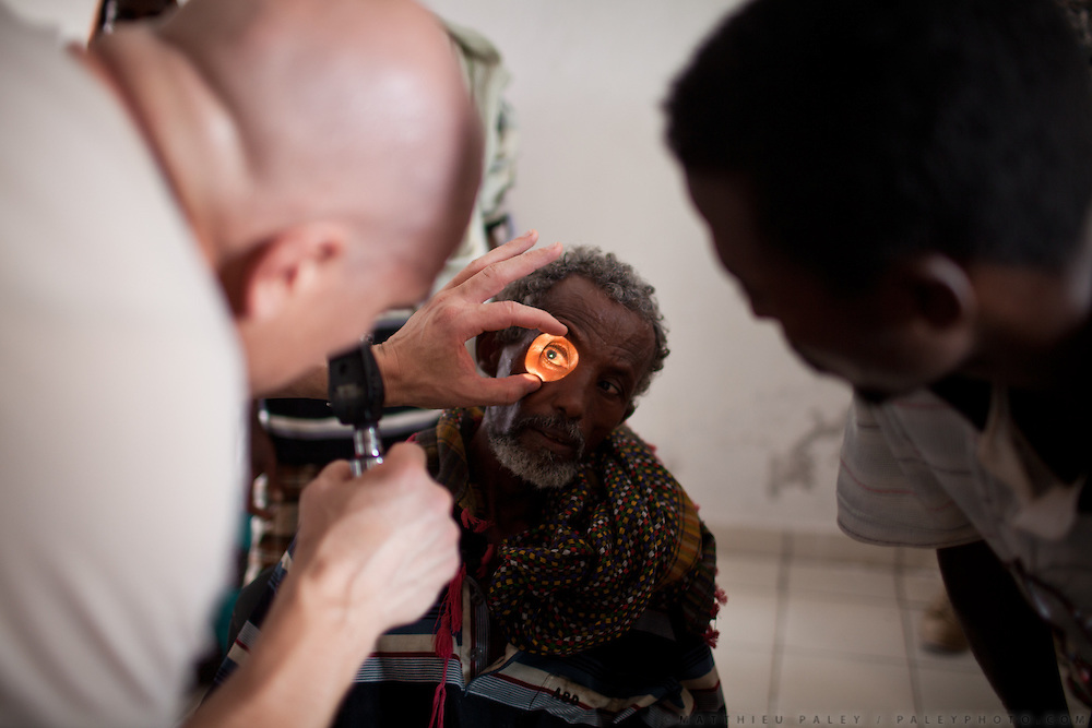 """Eye clinic...Military people from the Civil Affairs department of the US Army doing a trip to Sagallou (near Tadjoura), as part of a medical camp mission. Part of the """"3D approach"""" of the US Army : Development (in that case), Democracy, Defense...The geostrategical and geopolitical importance of the Republic of Djibouti, located on the Horn of Africa, by the Red Sea and the Gulf of Aden, and bordered by Eritrea, Ethiopia and Somalia."""