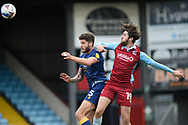 Scunthorpe United Aaron Jarvis (19) Mansfield Town Ryan Sweeney (5) battles for possession during the EFL Sky Bet League 2 match between Scunthorpe United and Mansfield Town at the Sands Venue Stadium, Scunthorpe, England on 26 December 2020.