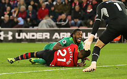 Watford's Nathaniel Chalobah (right) and Southampton's Ryan Bertrand (bottom) battle for the ball during the Premier League match at St Mary's Stadium, Southampton.