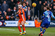 Wycombe Wanderers defender Sido Jombati defends the ball from Luton Town forward Danny Hylton during the EFL Sky Bet League 1 match between Luton Town and Wycombe Wanderers at Kenilworth Road, Luton, England on 9 February 2019.