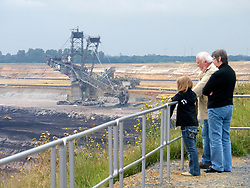 Visitors looking at  RWE open-cast brown or lignite coal mine at Garzweiler in Northrhine Westfallia in Germany
