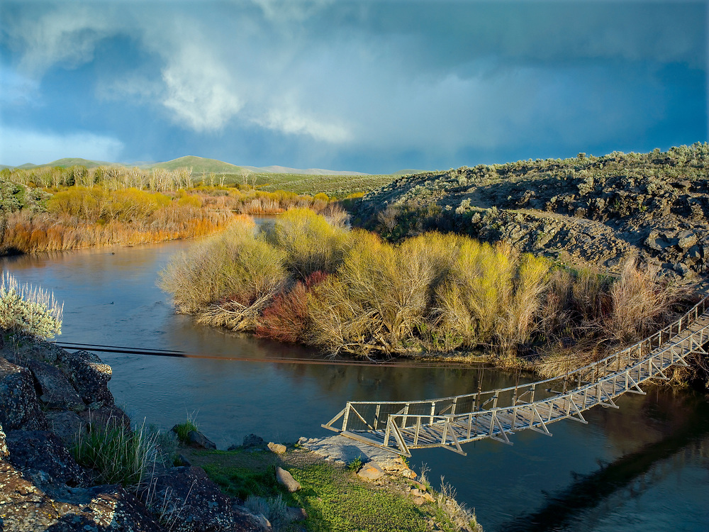 Limited Edition of 17<br /> The Sheep Bridge near Stanton Crossing on the Wood River just before it enters Magic Reservoir in South Central Idaho on a spring evening and dramatic clouds
