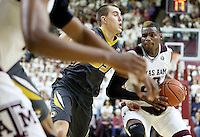 Texas A&M's Danuel House (23) drives the lane against Missouri's Cullen VanLeer (33) during the second half of an NCAA college basketball game, Saturday, Jan. 23, 2016, in College Station, Texas.  Texas A&M won 66-53.  (AP Photo/Sam Craft)