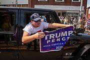 A Trump supporter taunts demonstrators at the Mifflinburg Pride Event.