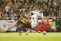 Real Madrid´s Karim Benzema (R) and F.C. Barcelona´s Dani Alves during the Spanish Copa del Rey `King´s Cup´ final soccer match between Real Madrid and F.C. Barcelona at Mestalla stadium, in Valencia, Spain. April 16, 2014. (ALTERPHOTOS/Victor Blanco)