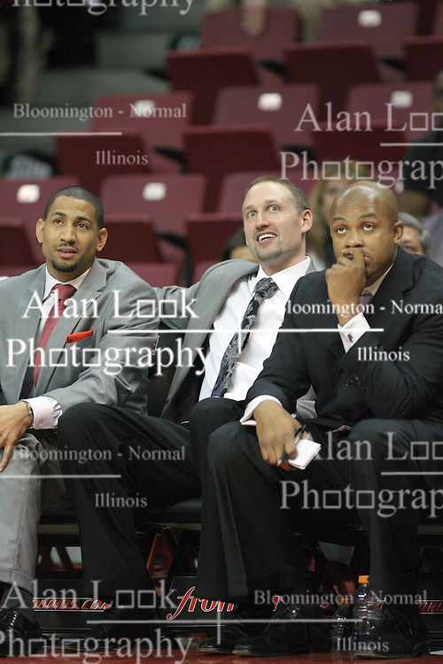 02 February 2013:  With a few seconds left in the game, Dana for and Torrey Ward sit on either side of a smiling Dan Muller during an NCAA Missouri Valley Conference mens basketball game where the Salukis of Southern Illinois lost to the Illinois State Redbirds for Retro-Night 83-47 in Redbird Arena, Normal IL