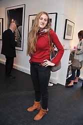 VIOLET NAYLOR-LEYLAND at a private view of an exhibition of photographs by Mike Figgis entitled 'Kate & Other Women' held at The Little Black Gallery, 13 A Park Walk, London SW10 on 22nd June 2011.