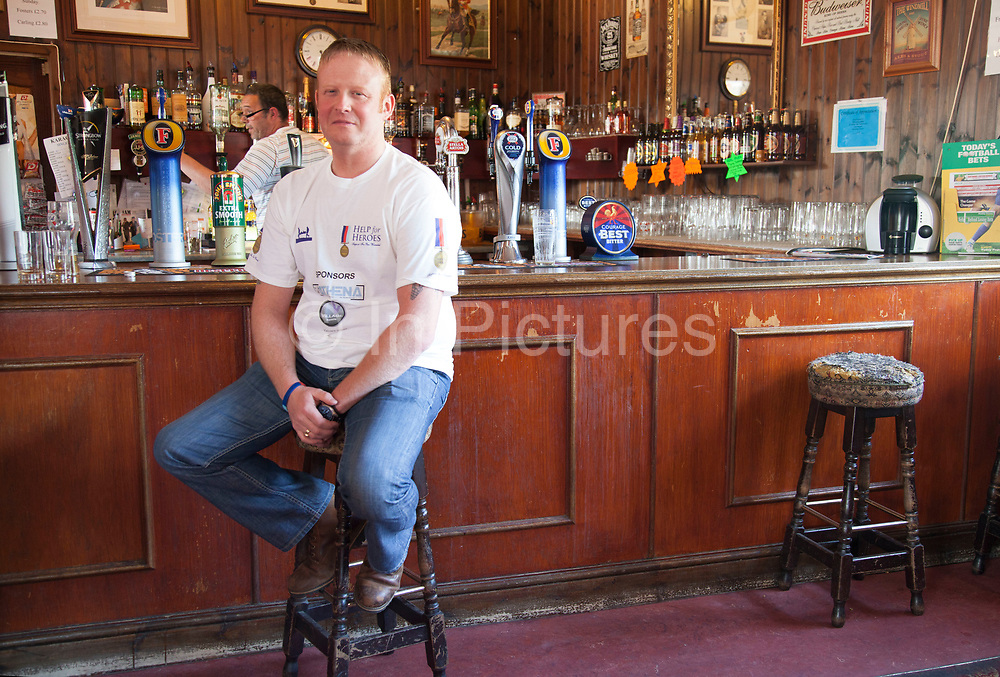 London, UK. Saturday 25th May 2013. Lee Horton (36) in the Kings Arms pub after visiting the memorial to Drummer Lee Rigby in Woolwich, London, UK. Horton, now in the security business was in a gunner in British Army Artillary, and now raising money along with many other servicemen for the charity Help for Heroes. The Kings Arms became a landmark in the area after is was bombed by the IRA in 1974.