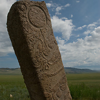 """A 2700+ year-old, bronze age Deer Stone stands on a hill called Ulaan Tolgoi (""""Red Hill""""), near Lake Erkhel & Muren, Mongolia."""