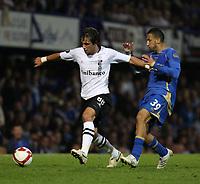 Fotball<br /> England<br /> Foto: Fotosport/Digitalsport<br /> NORWAY ONLY<br /> <br /> Jean Carloes Alves Coral (Vitorio SC) evades the tackle of Nadir Belhadj (Portsmouth) <br /> 18.09.08  Portsmouth v Vitorio SC UEFA Cup 1st Round Fratton Park