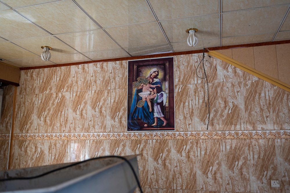 On October 19, 2016, ISIS was pushed out of the predominately Christian town of Qaraqosh, ending its destructive two-year occupation. Residents returned to find many of their homes looted, damaged, or even destroyed. In this photo, taken inside a Christian family's home, religious art on a wall has been vandalized. (May 5, 2017)