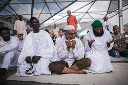 June 25, 2017 - Naples, NA, Italy - Muslims in Naples offer Eid prayers on the occasion of the Eid al-Fitr festival which marks the end of the holy month of Ramadan in the ''Piazza Garibaldi'' Square. The three-day festival, which begins after the sighting of a new crescent moon, marks the end of the fasting month of Ramadan during which devout Muslims abstain from food and drink from dawn to dusk. Muslims believe that the prophet Mohammed received revelations from God during the holy month of Ramadan which made up their holy guide Koran. (Credit Image: © Michele Amoruso/Pacific Press via ZUMA Wire)